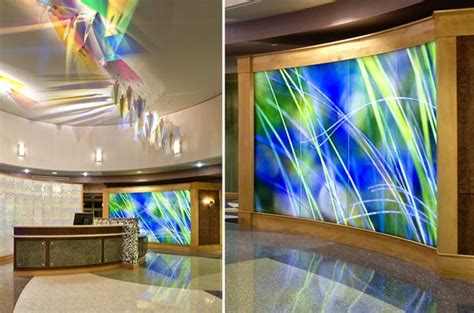 Glowing Interior Designs by Backlit Glass Panels Form A Glowing Feature Wall In