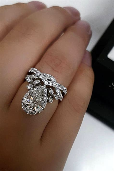 24 Stunning Pear Shaped Engagement Rings  Oh So Perfect. Affordable Engagement Rings. Affordable Wedding Rings. Square Shaped Engagement Rings. 3 Stone Oval Engagement Rings. Wedding Love Wedding Rings. Perfect Rings. Saphire Wedding Rings. Silver Cluster Wedding Rings