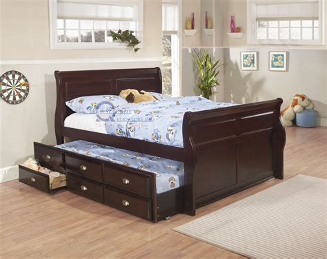 trundle bed with drawers wooden trundle bed with drawers zorginnovisie 17578 | interior dark brown wooden trundle bed with blue bedding set combined with drawers placed on the brown wooden flooring in the gray wall room wooden trundle bed