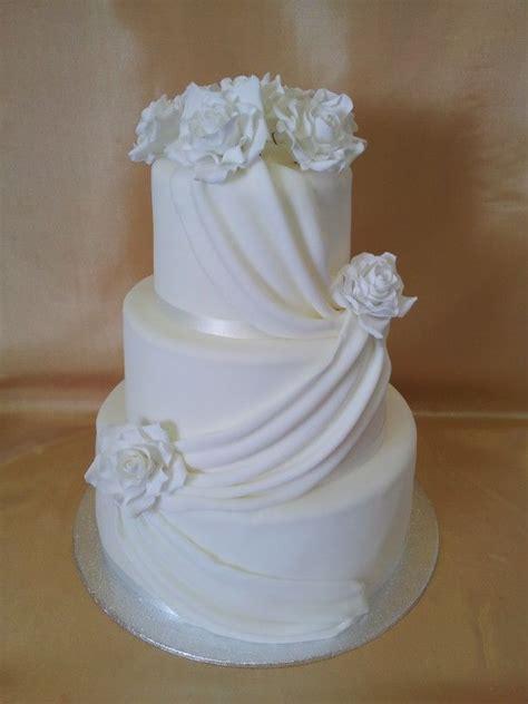 wedding cake drapes white wedding cake with drapes and roses steph s wedding