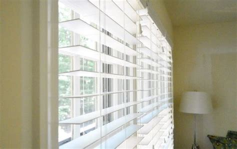 installing white faux wood window blinds front rooms