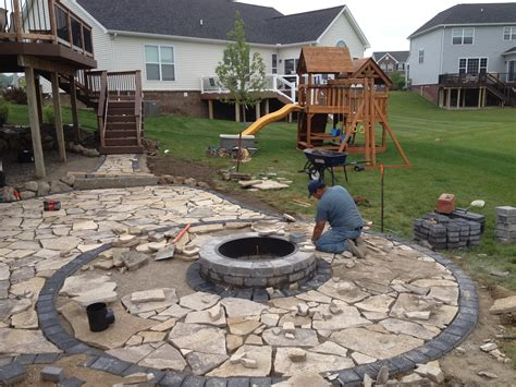 unilock canada construction of canadian flagstone patio with brick paver