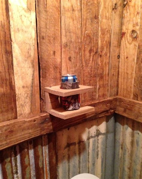 cave bathroom ideas my husband says a drink holder is necessary for the man cave bathroom man cave in the making