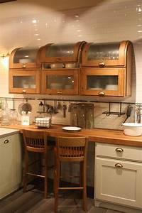 Wood kitchen cabinets just one way to feature natural material for Kitchen cabinet trends 2018 combined with rod iron wall art home decor