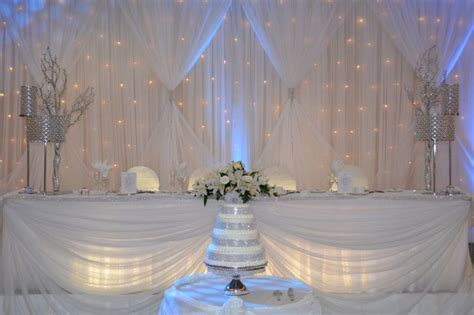 light blue and white wedding decorations white with silver bling and light blue uplighting with