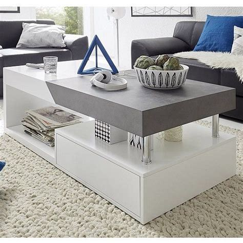Whether you are looking for a modern rectangular, square, round or an oval extendable dining table set, be sure to choose one that matches the event and desired ambience. Tuna Extendable Storage Coffee Table In Matt White And Concrete | Center table living room ...