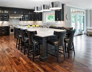 black kitchen island with seating kitchen island with seating kitchen transitional with eat in kitchen stained wood floor