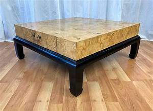 large burl wood coffee table with drawers attributed to With large wooden coffee table with drawers