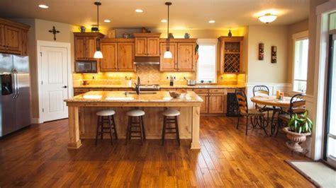 white washed wood floors light cabinets kitchen buzzard