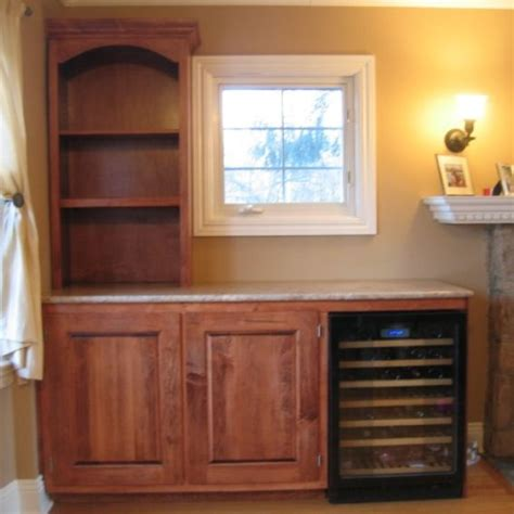 handmade custom cabinet built to incorporate wine cooler