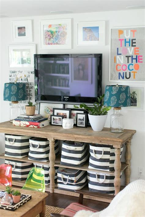 hide your television when not in use by building this tv lift 5 tips for decorating around a television