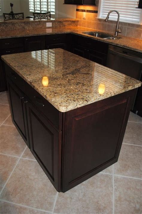 nv gold granite maple cabinets in cranberry with black
