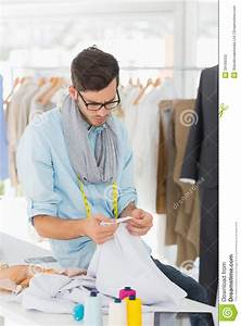 Concentrated Male Fashion Designer At Work Stock Photo