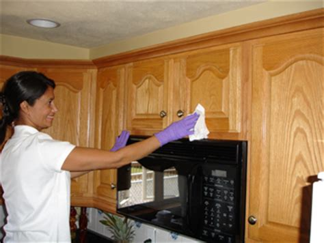 cleaning wood kitchen cabinets how to clean grease from kitchen cabinet doors ehow uk