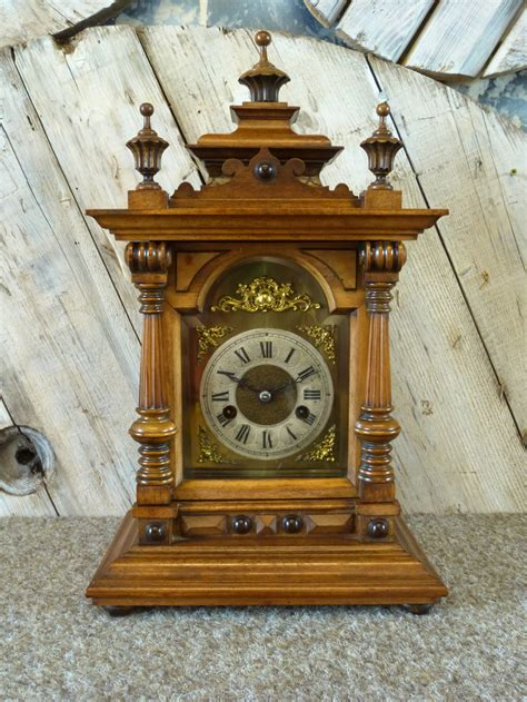 walnut cased striking mantel clock