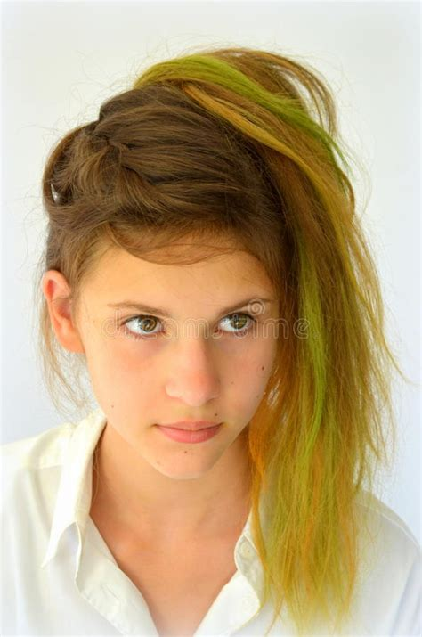 Girl With Long Hair Dyed With Colored Strands Stock Photo