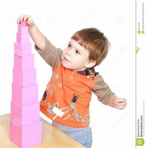 Little Boy Learn To Put Pink Pyramid In Montessori Stock ...