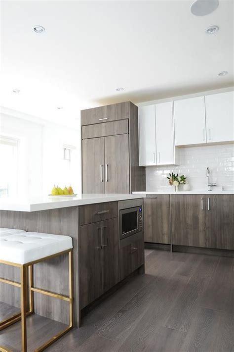 gray veneer kitchen island topped   white quartz