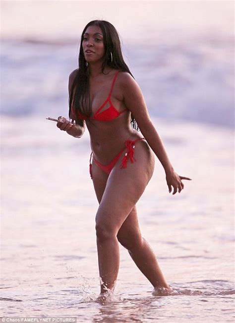 Porsha Williams shows off her curves while on holiday in