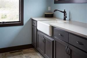 Apron front sink with a quartz countertop traditional for Laundry room sink and countertop