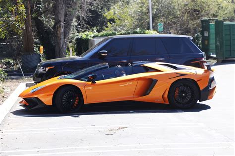 lamborghini aventador s roadster orange kylie jenner stepping out of her orange lamborghini aventador roadster los angeles 03 11 2017