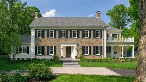 georgian style home traditional colonial house with woodlands
