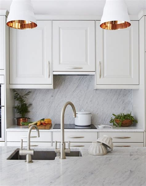 white traditional kitchen  copper lined pendant lights