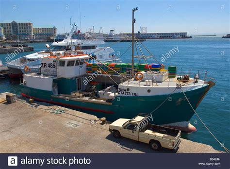Boat Auctions Cape Town by Fish Trawler Unloading Its Catch In The Harbour Of Cape