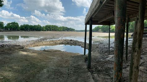 lake dunlap partially drained spill gate collapse