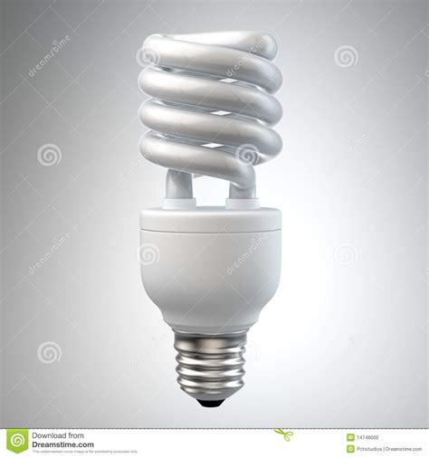 white energy saving light bulb on white stock photo