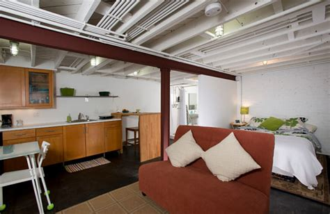 Exposed Basement Ceiling Lighting Ideas by Stylish Basement Apartment Ideas