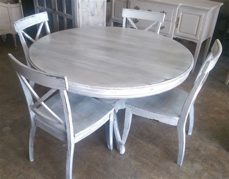 here is a 54 quot table and four chairs i painted it