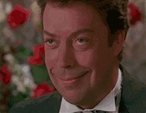 tim curry home alone 2 smile gif find on giphy 47352