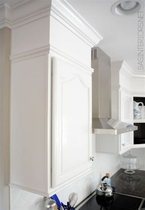 basic upper cabinets  moulding added  give upscale