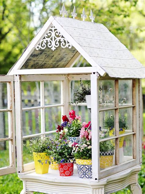 Great diy idea for making a greenhouse out of old windows. DIY Backyard Mini Greenhouse | HGTV