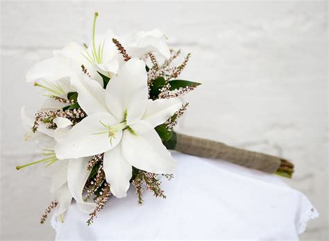 White Lillie's With Yellow Ragweed Instead Of Accent Shown