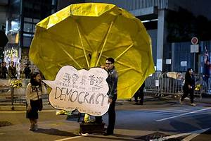 Hong Kong: Defiant protesters give Hunger Games' three ...