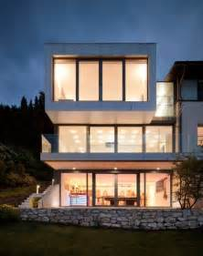 three story homes three storey extension to a lakeside house featuring an open and asymmetrical design
