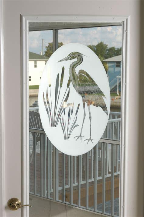 unique front door sidelight window film  egrets