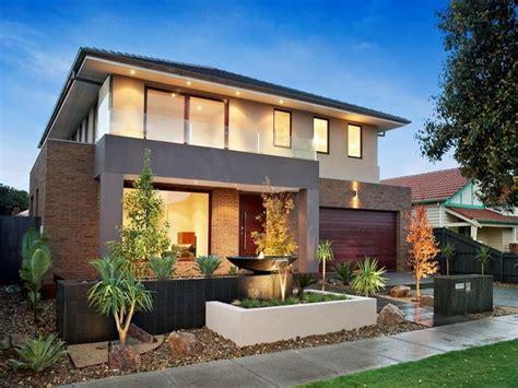 custom home interiors mi brick modern house exterior with balcony house facade photo 511075