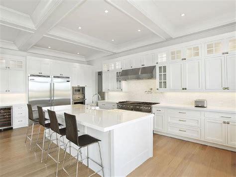 white kitchen with island white kitchen island with wood barstools