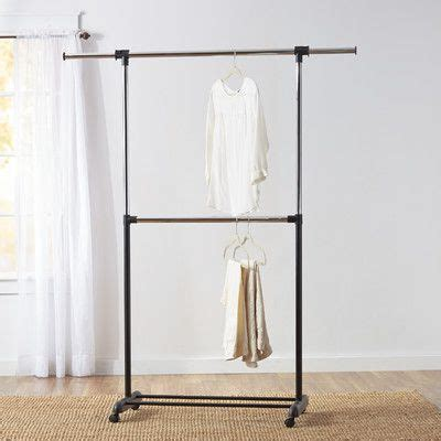features dual rod hanging metal clothesline poles