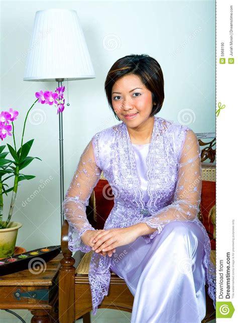 malay woman  purple lace dress  long skirt stock