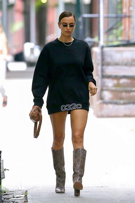 irina shayk flaunts her super model legs in a mini dress ...