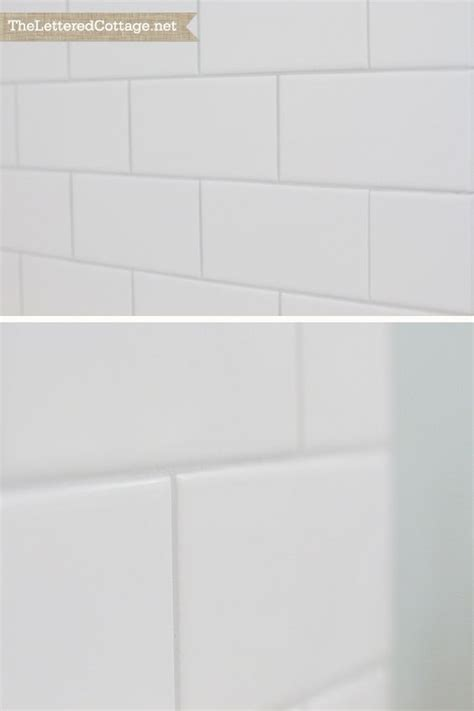 warm gray grout white subway tile bathroom organization