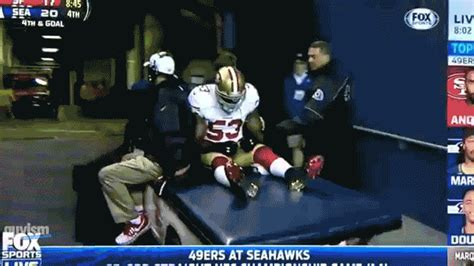 seattle seahawks fans throw food  injured ers star