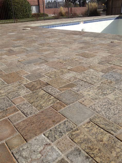 recycled granite paving on pool deck contemporary