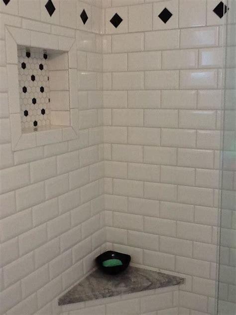 white subway tile shower  black accents black white
