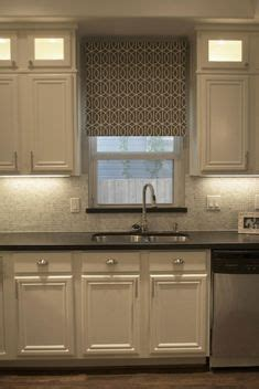 lighted kitchen cabinets kitchens white cabinets steel gray granite carrara 3767