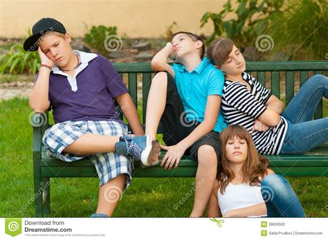 Teenage Boys And Girls Resting On The Bench Stock Image